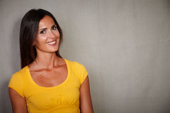 Charismatic female looking at camera while smiling Royalty Free Stock Images
