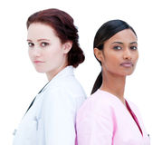 Charismatic female nurse and doctor standing Stock Photo