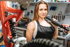 Charismatic feminine craftswoman standing in the workshop Stock Photo