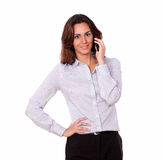 Charismatic girl in blouse talking on mobile phone Royalty Free Stock Photos