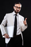 Charismatic guy in a suit with ntebook Royalty Free Stock Photos