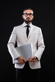 Charismatic guy in a suit with ntebook Stock Images