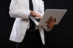 Charismatic guy in a suit with ntebook Stock Photos