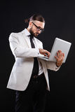 Charismatic guy in a suit with ntebook Stock Image