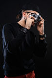 Charismatic guy in sweater , glasses  photo camera Royalty Free Stock Photography