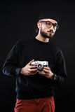 Charismatic guy in sweater , glasses  photo camera Royalty Free Stock Photo
