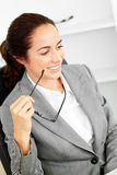 Charismatic hispanic businesswoman holding glasses Royalty Free Stock Photography