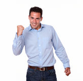 Charismatic hispanic man celebrating his victory Royalty Free Stock Images