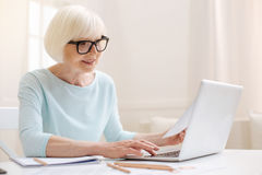 Charismatic intelligent lady writing an email Stock Image