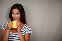 Charismatic lady holding coffee cup while standing Stock Photography