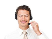 Charismatic latin businessman using headset. Isolated on a white background Royalty Free Stock Photography