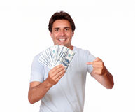 Charismatic latin male holding cash money Royalty Free Stock Photos