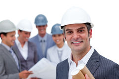 Charismatic male architect in front of his team. Charismatic male architect standing in front of his team Stock Photos
