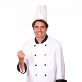 Charismatic male chef celebrating a victory Royalty Free Stock Photo