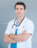 Charismatic male doctor looking at the camera Royalty Free Stock Images