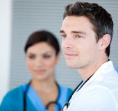 Charismatic male doctor looking at the window Royalty Free Stock Image