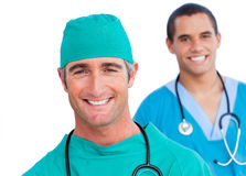 Charismatic male doctors standing in a line Stock Photo
