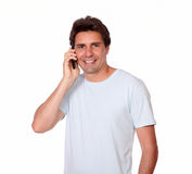Charismatic male smiling speaking on cellphone Stock Photos