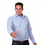 Charismatic male standig with greeting gesture Stock Photography