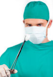 Charismatic male surgeon holding surgical forceps Royalty Free Stock Photography