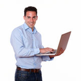 Charismatic male using his laptop computer Stock Photos