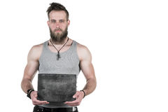 A charismatic man with a beard holds an empty gray plate for a copy space on a white isolated background Royalty Free Stock Photo