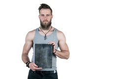 A charismatic man with a beard holds an empty sign for a copy space, on a white isolated background. Horizontal frame Stock Photography