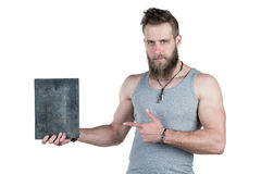A charismatic man with a beard holds an empty sign for a copy space, on a white isolated background. Horizontal frame Royalty Free Stock Photography