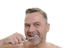 Charismatic man cleaning his teeth Royalty Free Stock Photos