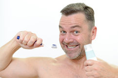 Charismatic man cleaning his teeth Stock Images