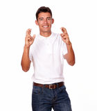 Charismatic man crossing fingers sign for luck Stock Photos
