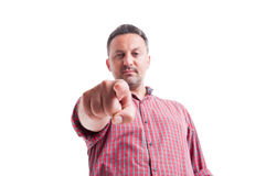 Charismatic man gesturing you are fired, hired or selected Royalty Free Stock Photography