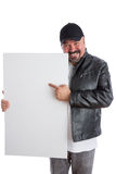 Charismatic man pointing to a blank white sign Stock Image
