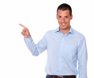 Charismatic man pointing to his right Royalty Free Stock Images