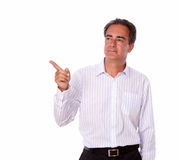 Charismatic man pointing to his right Royalty Free Stock Photography