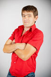 Charismatic man in red shirt Stock Images