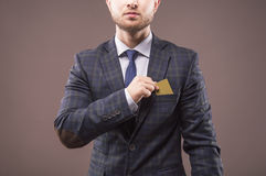 Charismatic man in suit puts the card Stock Image