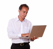 Charismatic man working on his laptop Royalty Free Stock Photo