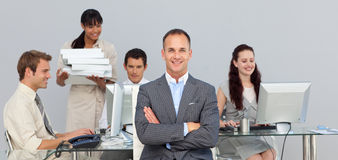 Charismatic manager with folded arms Stock Photos