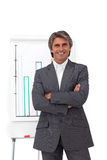 Charismatic mature businessman with folded arms Stock Photography
