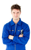 Charismatic mechanic holding tool and smiling Stock Images