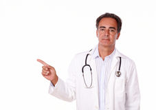 Charismatic medical doctor pointing to his right Stock Images