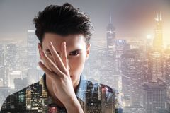 Charismatic model keeping fingers in front of his face. Shrewd look. Close up of charismatic model keeping fingers in front of his face while being in urban Royalty Free Stock Photo