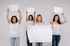 Charismatic powerful women protesting against inequality Stock Images
