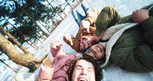 Charismatic and smiling large group of friends enjoying the time together using a camera to make some selfies they