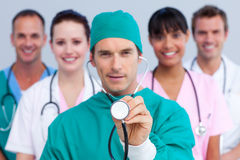 Charismatic surgeon and his medical team Stock Photo