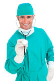 Charismatic surgeon holding a stethoscope Stock Photos