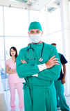 Charismatic surgeon wearing a surgical mask Stock Images