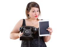 Charismatic woman comparing old and modern devices Stock Images