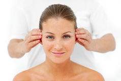 Charismatic woman having a head massage Royalty Free Stock Image